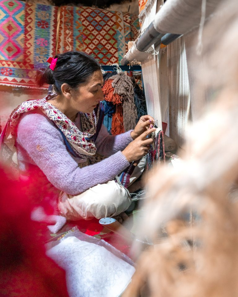 Female carpet weaver artisan working in Gulmit, Hunza, Pakistan
